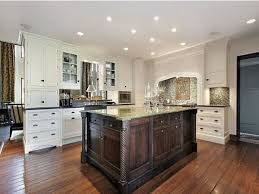 plain kitchen ideas with white cabinets dark island stained for