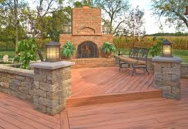 timbertech deck with retaining walls and outdoor fireplace