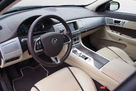 jaguar jeep inside 2015 hyundai genesis 3 8 awd vs jaguar xf 3 0 awd autoguide com