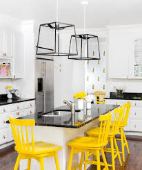 yellow vintage counter stools with beadboard island contemporary