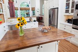 white cabinets with butcher block countertops how to care for your butcher block countertops cabinets by graber