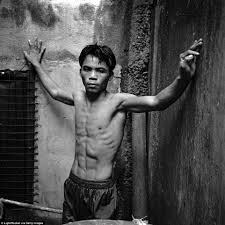 manny pacquiao pictured as a young teenage boxer in gym as he