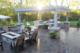 functional outdoor rooms make this unilock richcliff patio the