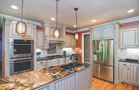 kitchen upgrades worth splurging on houseplansblog dongardner com granite slab accent piece for the island in the kitchen of the fincannon house plan