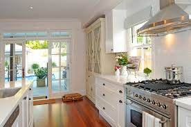 white shaker cabinets with black countertops top knobs appliance