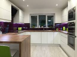 White Gloss Kitchen Ideas Contemporary White Gloss Kitchen Purple Glass Splash Back Lime