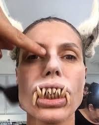 10 Amazing Heidi Klum Halloween Costumes Copy Heidi Klum Shows Huge Fangs Halloween Daily Mail