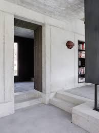 industrial glass door home design grey concrete kitchen island near black brown