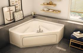 bathroom corner bathtub by maax bathtubs with shelf and tile