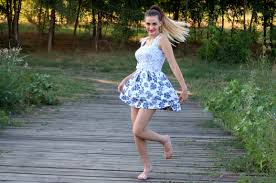 woman in blue and white skated dress free stock photo