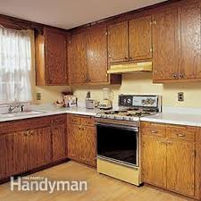 How To Refinish Kitchen Cabinets Family Handyman - Diy kitchen cabinet refinishing