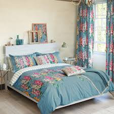hollyhocks bedding in petrol blue and floral by sanderson at