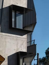 woods bagot u0027s zinc clad apartments echo industrial context in