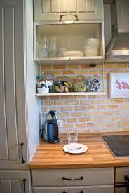 Kitchen With Brick Backsplash by Kitchen Remodelaholic Tiny Kitchen Renovation With Faux Painted