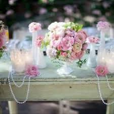 vintage birdcages or lanterns full of flowers make for a budget