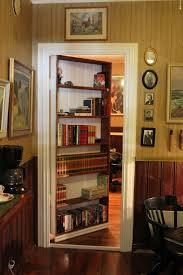 exterior beautiful secret room behind bookcase door with vertical