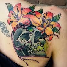 55 lily tattoos on back shoulder