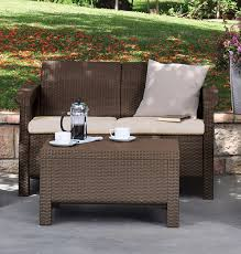outdoor indoor outdoor patio loveseat with cream cushions
