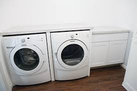 how to install base cabinets in laundry room iheart organizing laundry room update installing a drop in