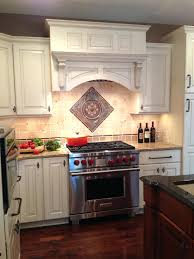 kitchen backsplash medallions sonoma tile backsplash kitchen remodel features a tumbled