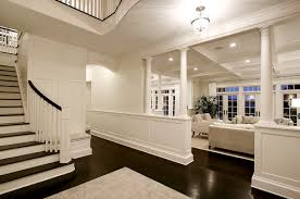 is the wood paneling and walls painted the same color white and finish