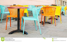Teal Colored Chairs by Pastel Colored Chairs On A Street Cafe Stock Photo Image 56095339