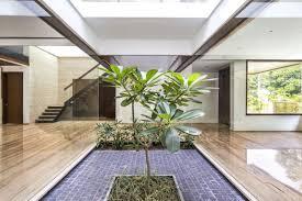 a sleek modern home with n sensibilities and an interior courtyard