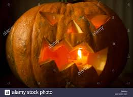 halloween pumpkin with candle inside jack o lantern carved
