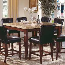 square high granite top dining table and 8 leather upholstered