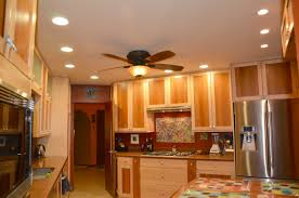 living room hanging fan ceiling light refrigerator kitchen