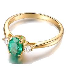 gold emerald engagement rings trilogy half carat oval cut emerald and engagement
