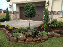 Backyard Flower Bed Designs Japanese Blueberry Tree With Petunias Sea Green Juniper And