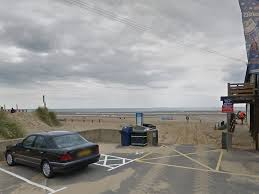 camber sands body found and two hospitalised after swimming off