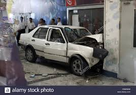 white volkswagen jetta car crashes in a mall a white volkswagen jetta crashes into a wall