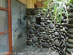 river rock bathroom ideas what a totally cool idea to use river rocks as towel hooks i