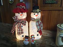 i made these snowmen out of large pickle jars and light globes