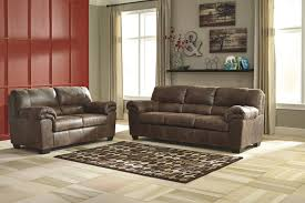bobs furniture home theater seating casual faux leather sofa by signature design by ashley wolf and
