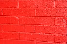 red painted brick wall outside the building preview save to a