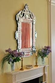 Venetian Mirror Fireplace Mantel With Glass Vases And Venetian Mirror Elegant
