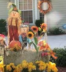Fall Harvest Outdoor Decorating Ideas - my fall yard decor yellow mums pumpkins hay bale and a cute