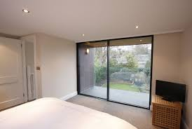 Interior Crawl Space Access Door by Minimal Windows Allow Near Frameless Access To The Small Balcony