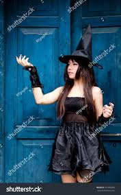blue witch costume beautiful asian woman witch costume halloween stock photo