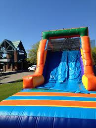 bounce house foam party water slide moonwalks snow houston