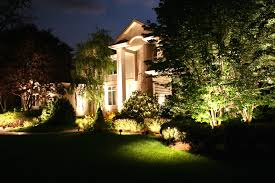 residential landscape lighting design with outdoor oasis in the