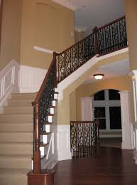 Oak Banisters Luxury Home Foyer Design Detail Wrought Iron And Oak Banisters