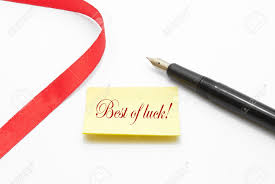 paper with writing on it best of luck written on a note paper with a pen beside it and best of luck written on a note paper with a pen beside it and decorated with