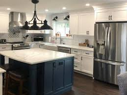 how to paint stained kitchen cabinets painting vs staining kitchen cabinets and why you ll want to