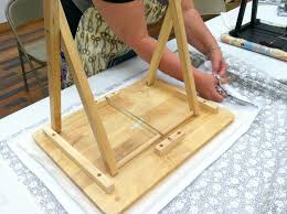 How To Make A Sewing Table by Step 12 Secure Ironing Board Base To Plywood Top
