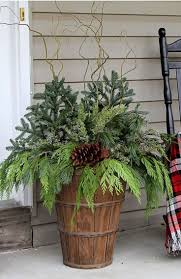 best 25 outdoor christmas planters ideas on pinterest christmas