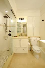 bathroom storage cabinets above toilet with traditional tile